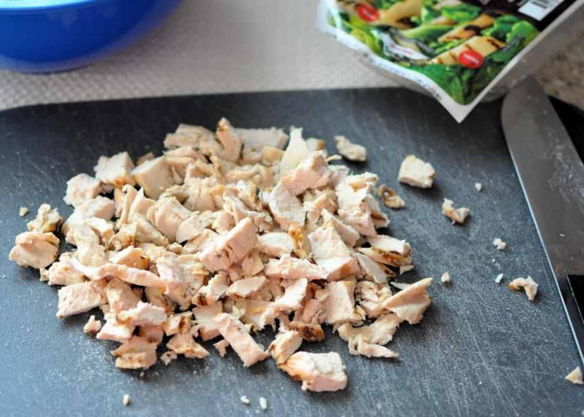 chopped chicken on cutting board