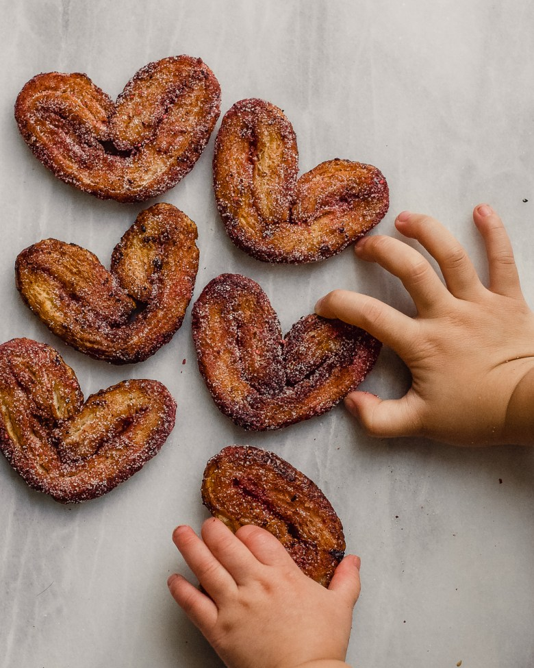 kids reaching for raspberry palmiers