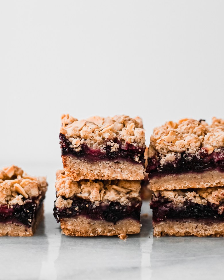 berry crumb bars stacked