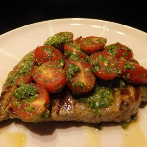 Steak with salsa verde and tomatoes