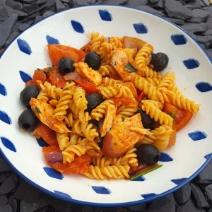 Pasta with salmon and black olives
