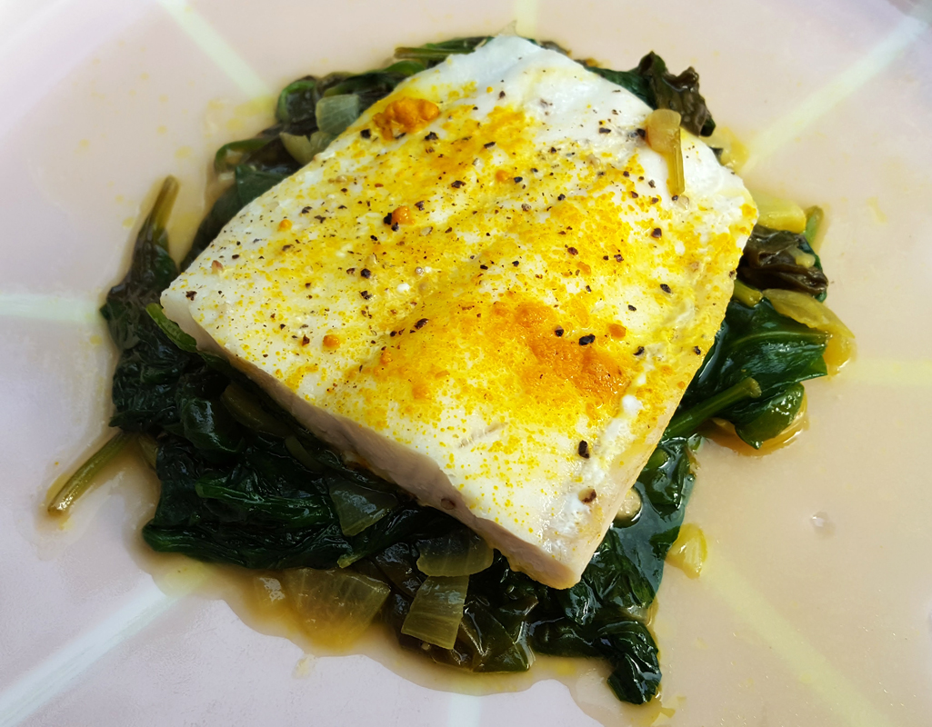 Braised haddock with spiced spinach