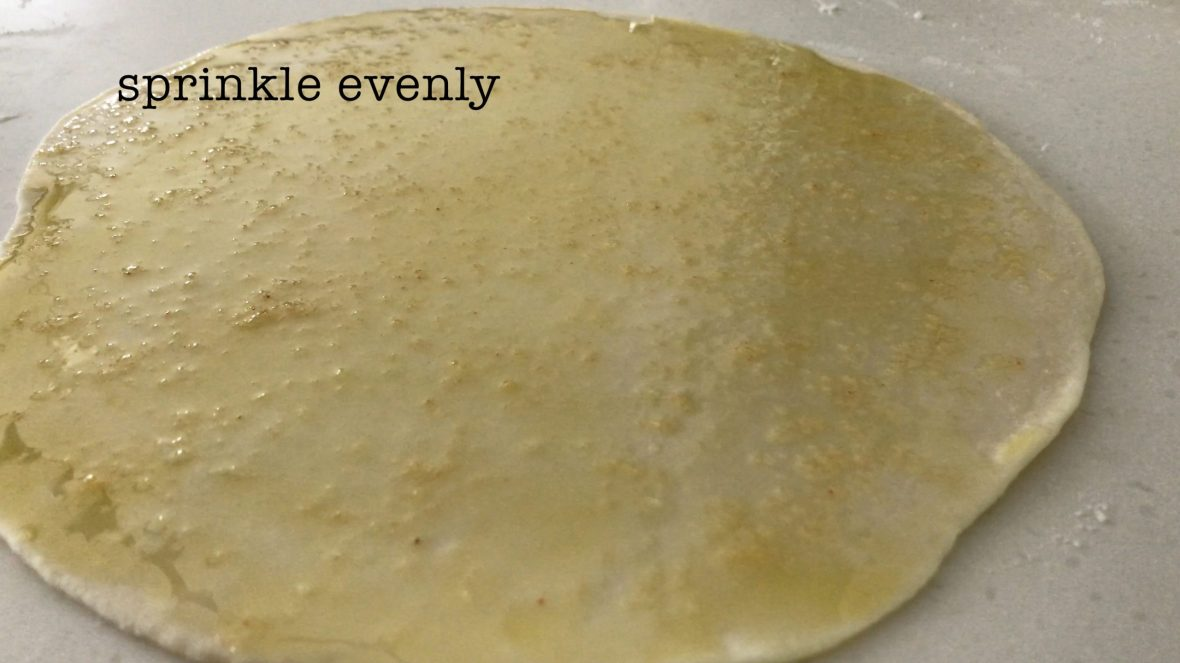 A flatten dough covering with sea salt and olive oil