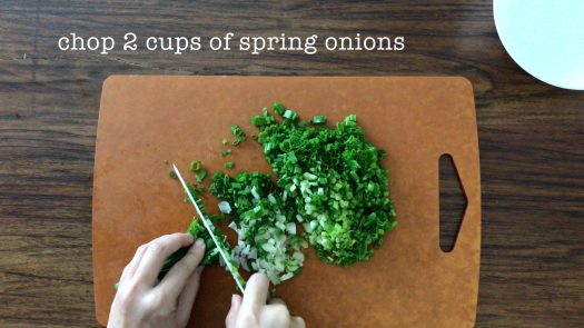 Chopping some scallions on a chopping board