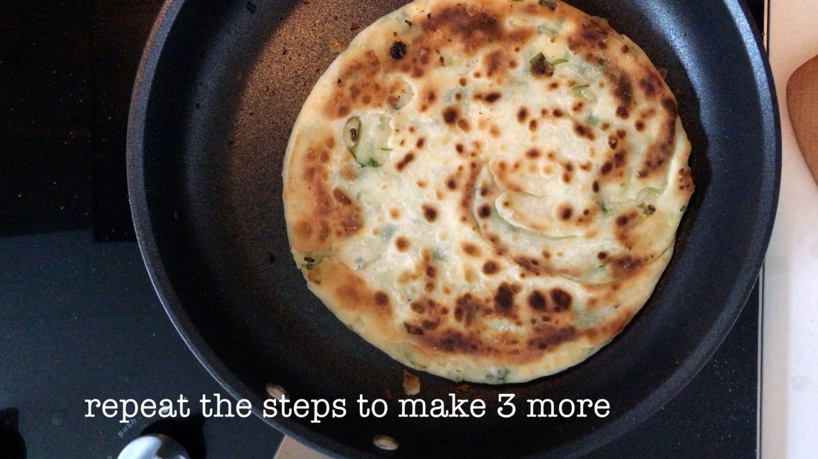 A cooked Chinese scallion pancake in a pan