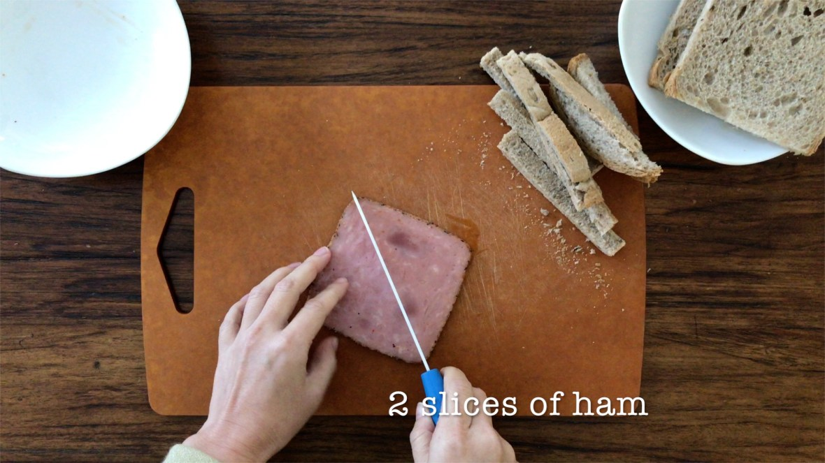 Halve two slices of black pepper ham diagonally