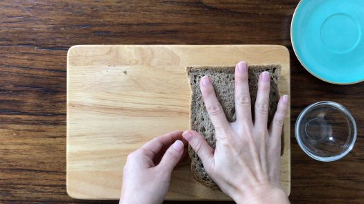 Cover the fillings with the other slice of brown bread with peanut butter and press the sandwich slightly