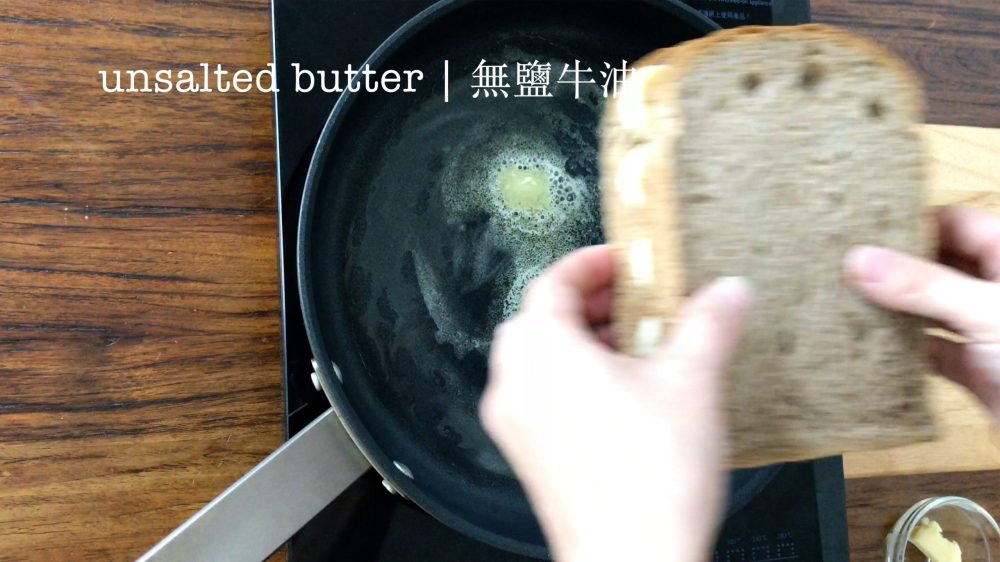 Put the sandwich into a pan with melted butter