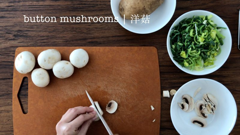 Slicing a few button mushrooms