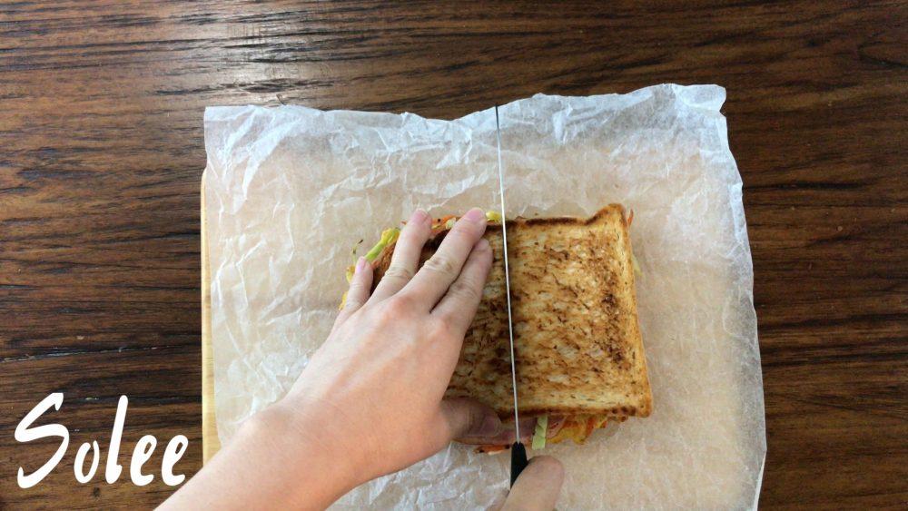 cutting the Korean sandwich into half
