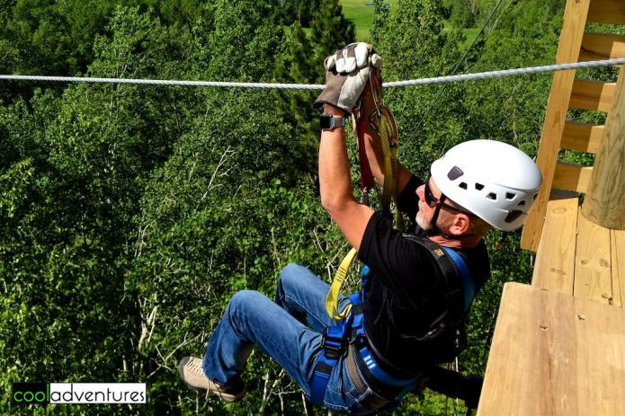 Greg Hull takes off of tower one at Zip Line Brainerd