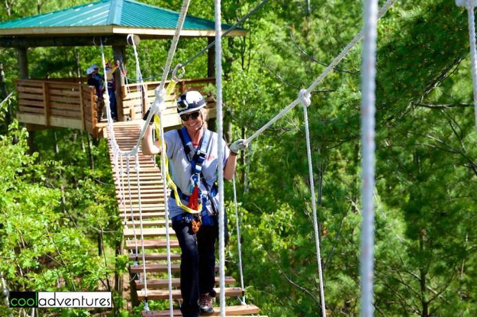 Kim Hull on the suspension bridge, Brainerd Zip Line Tour, Brainerd Lakes, Minnesota