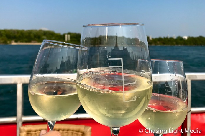 Enjoying wine aboard Montreal river cruise