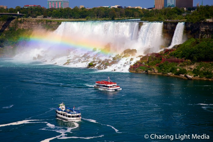 Maid of the Mist & Hornblower cruise boats passing American Falls, Niagara Falls, Ontario, Canada