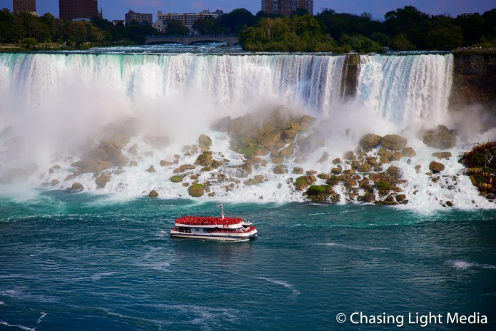 Hornblower cruise boat goes in for a close look at American Falls, Niagara Falls, Ontario, Canada