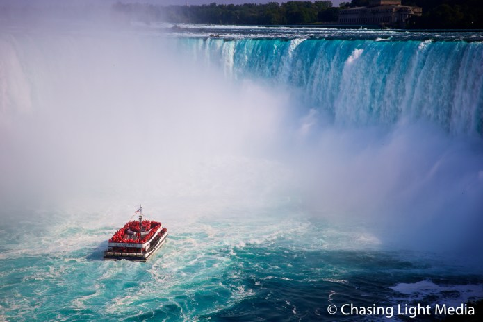 Passengers aboard the Hornblower appreciate their ponchos as the boat pulls closer to Horsehoe Falls, Niagara Falls