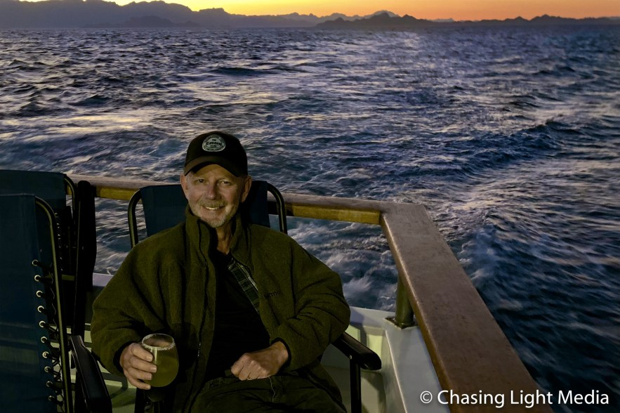 Greg Hull sipping a margarita at sunset on the Searcher