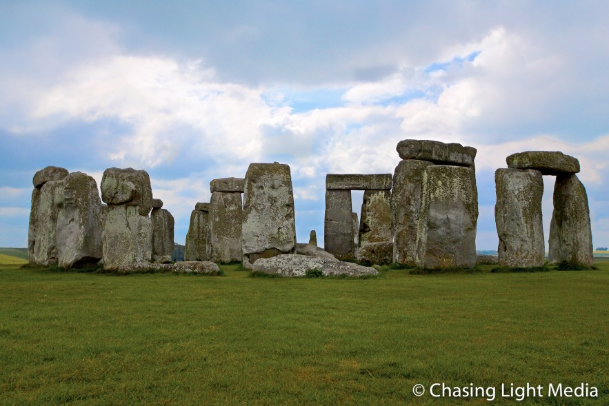 Stonehenge against a blue sky with approaching clouds