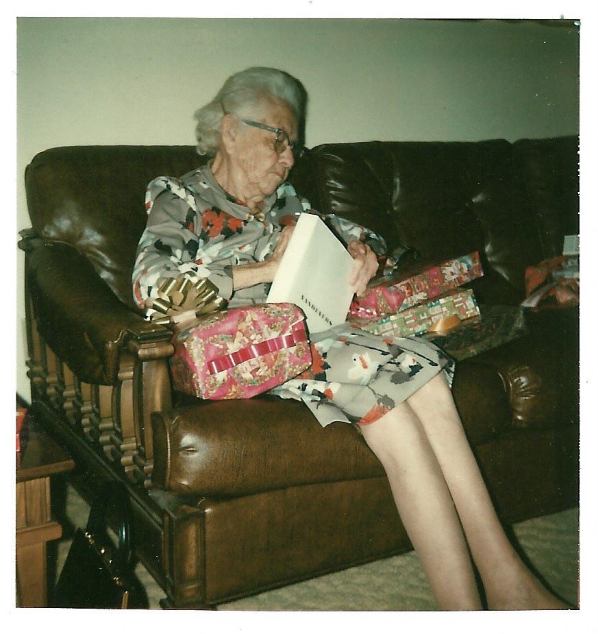 Myrtle Hooper Phillis opening gifts, 1976