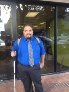 Photo of Gabe Vega standing in front of his office in Arizona