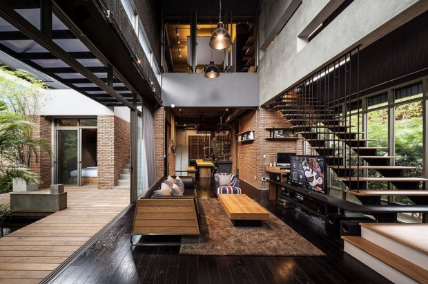 central-living-area-opens-onto-a-courtyard-and-pool-area-in-this-home-located-in-bangkok-thailand