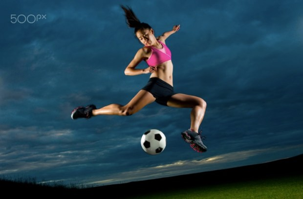 Japanese woman playing soccer