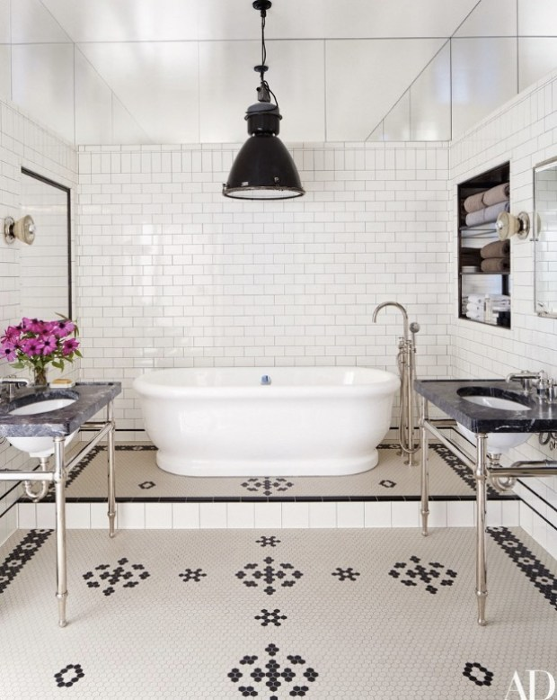 bathroom-features-a-raised-tub-and-subway-tiles-in-this-soho-apartment