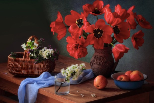 With a bouquet of red tulips