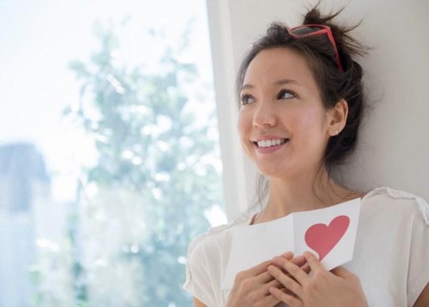 woman holding Valentine card