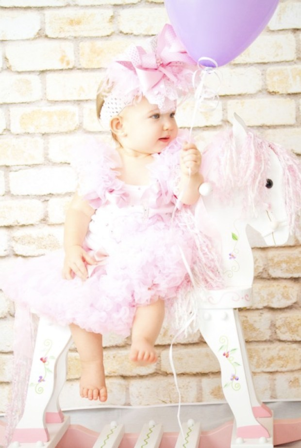 Cute pink doll on her horse
