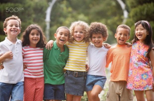 Portrait of children arm in arm