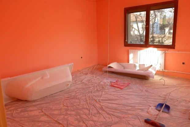 Empty newly painted room in orange color
