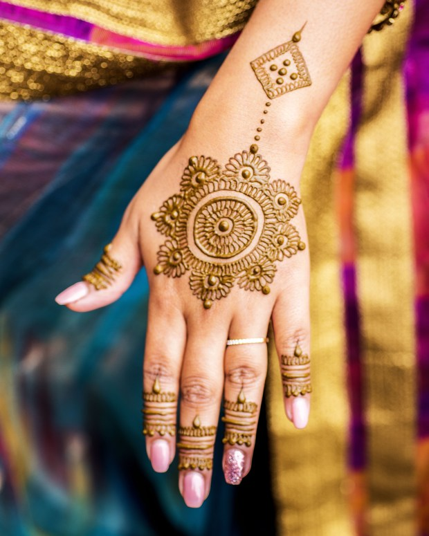 Carefully painted intricate design using henna