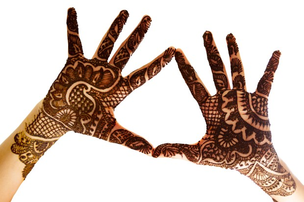 The hands together to show the beautiful Henna tattoo at the open hands