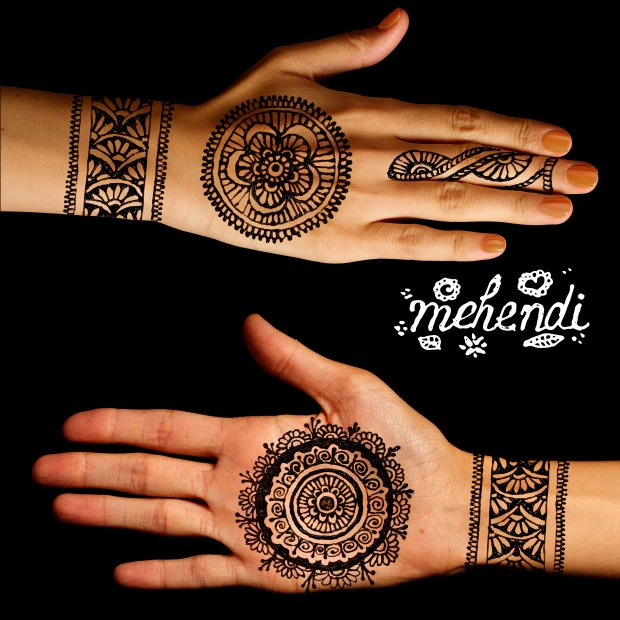 hands with mehendi hand band and circular design