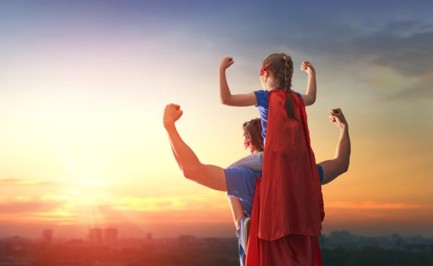Daddy and child girl in an Superhero's costumes