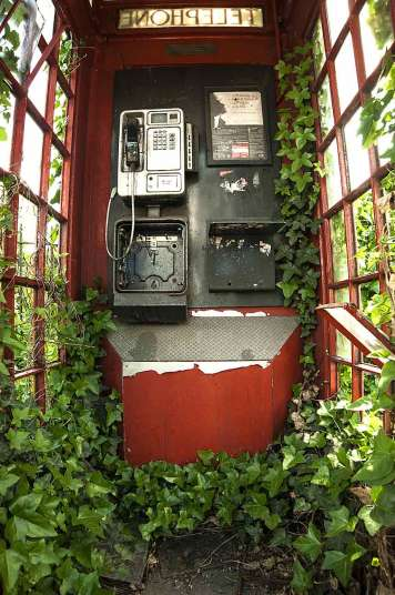 Green and red telephone box taken in London by Philip Braude