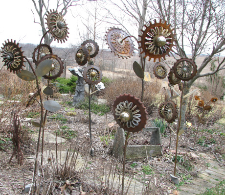 rusty metal flowers garden art 12 Ideas How To Create Unique Garden Art From Junk