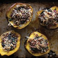 Baked Acorn Squash Stuffed wIth​ Rainbow Chard, Pecans, and Herbed Barley