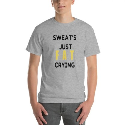 Smiling man wearing a short sleeve grey t-shirt, with slogan in yellow & black which says sweat's just fat crying.