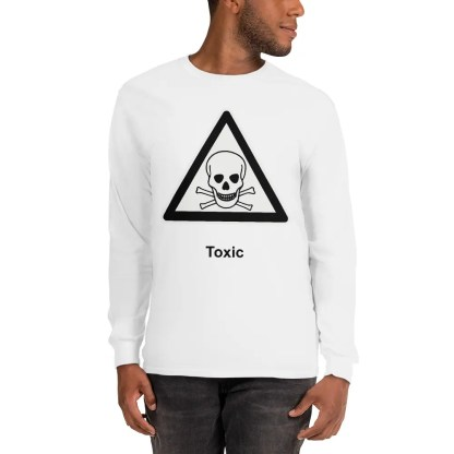 A man wearing a white long sleeved t shirt with a skull & crossbones inside a black triangle with the word toxic underneath.