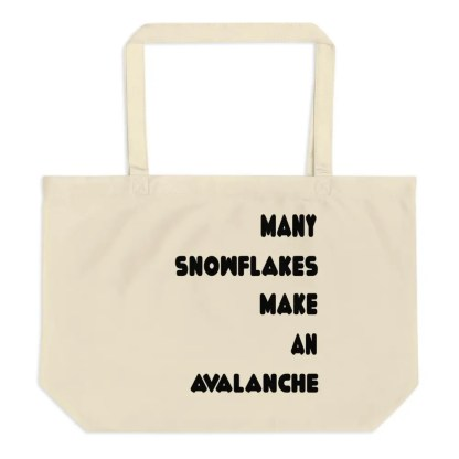 A beige colored cloth bag on a white background with the slogan many snowflakes make an avalanche