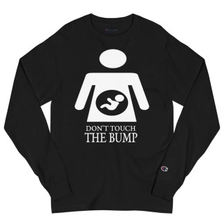 A black long sleeved Champion brand t shirt lying flat on white background with the slogan don't touch the bump underneath a graphic of a woman with a baby in her tummy