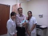 Jay visiting Dr. Fabian & staff at 3 weeks after birth