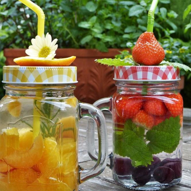 mason jars with fruit in water