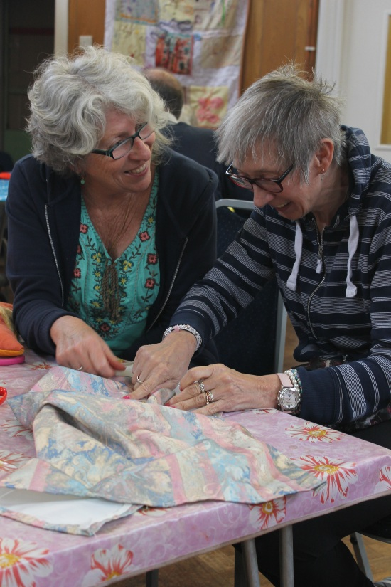two people looking at creative fabric