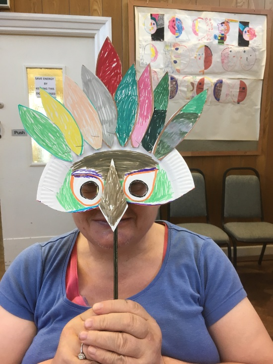 a person with a bird mask