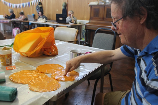 a man is making flower petals from old plastic bags