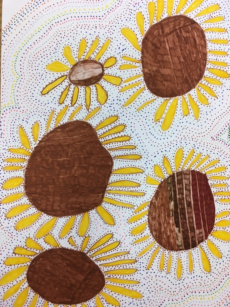 sunflowers are drawn with brown centres, which are surrounded by large yellow petals and the background is made up of rhythmic dots of colour