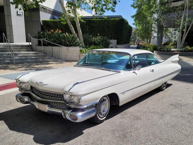 A White 1959 Cadillac Series 62 With Proper-Sized Tail Fins